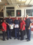 Donna Shaw of ReMax Around Atlanta and business partner Reponzell Morris delivered gift baskets to public safety agencies around South Cobb.