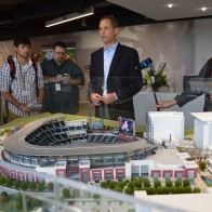 Derek Schiller, executive vice president of sales and marketing for the Atlanta Braves, gives members of the media a tour of the model.