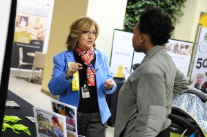 Lyn Cohen, left, talks to an Expo attendee about the various languages programs KSU's College of Continuing and Professional Education has to offer.