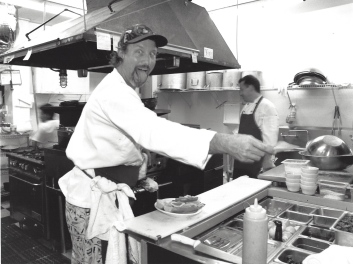 Henry working in the original kitchen just down the street from its current location.