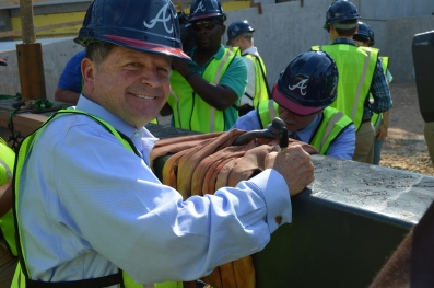 Chamber President & CEO David Connell signs the 1422 lb beam that will placed atop SunTrust Park.