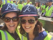 Executive Director of the Cumberland Community Improvement District and Chamber COO Sharon mason pose for a selfie before the beam is hoisted into the air.