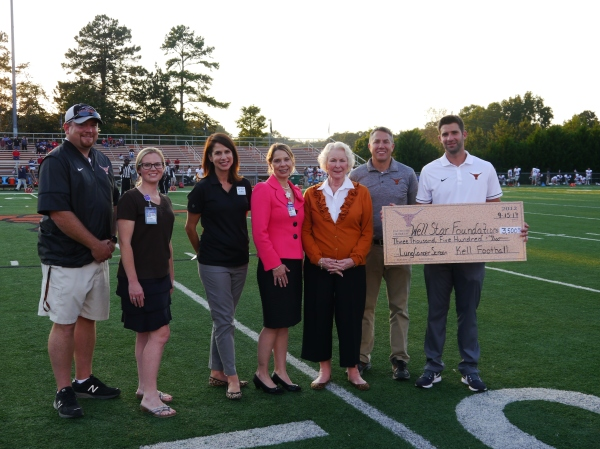 Kell High school check presentation 17